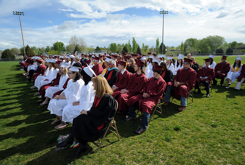 Graduates listen to speeches during the Berthoud High School graduation at Max Marr Field on Saturday, May 21.