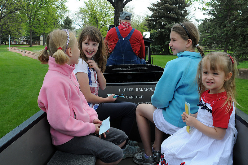 Buckhorn Northern Railroad engineer Harvey Ruegsegger, back, operates the train Saturday afternoon while passengers, front from left, Vivienne Penfold, 7, Hannah Vlagg, 10, Stella Penfold, 9, and Bella Bradford, 3, enjoy the ride around tracks at North Lake Park.