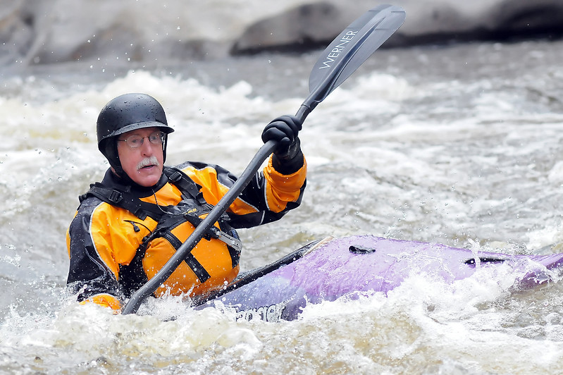 Bellvue resident Ben Thomas paddles his kayak through a section of rapids while playing on the Poudre River on Wednesday afternoon.