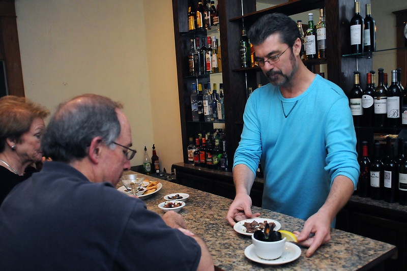 Sofia's Bistro co-owner Jeff Morrow, right, serves a variety of items off the tapa menu to Elaine Craft, left, and Wythe Hull on Thursday, May 19, 2011 at the restaurant's Loveland location at 1120 N. Lincoln Ave.