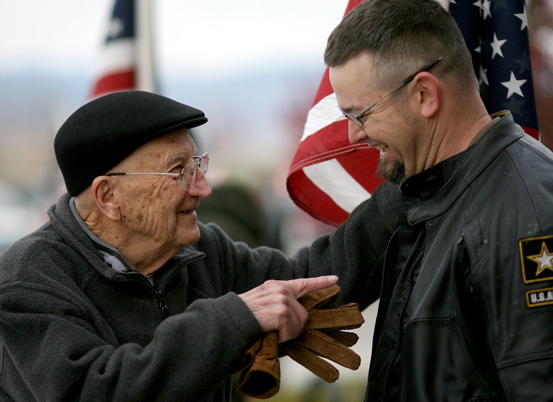 Charles Kavalec, left, jokes with Mike Volkmann, a Patriot Guard Rider, Sunday at the Embassy Suites in Loveland. (Photo by Gabriel Christus)