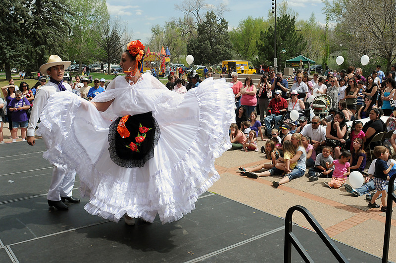 "Baile Folklorico de Mexico dancers Juan Guerrero, 14, left, a Conrad Ball Middle School eighth grader, and Mountain View High School sophomore Raquel Karlin, 15, perform a dance called ""Cascabel"" while entertaining attendees to the Cinco de Mayo Celebration on Saturday afternoon at Foote Lagoon."