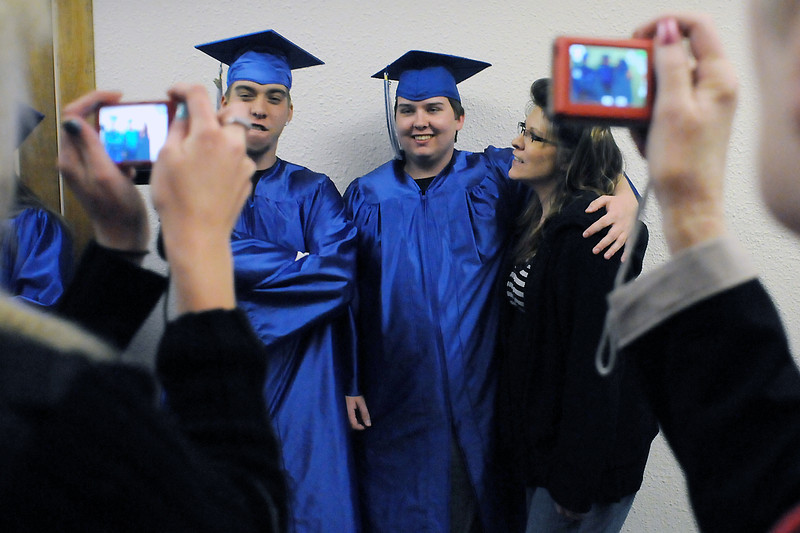 Loveland resident Andrew Hannig, center, poses with his mother, Colleen Hannig, and fellow graduate Tim Ballard prior to the Center for Adult Learning in Loveland's graduation ceremony on Wednesday at Bill Reed Middle School.