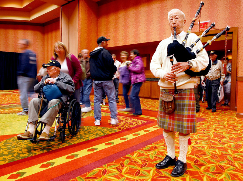 James G. Ling plays the bagpipes while Veterans head toward the busses to take them on their way to Washington DC on Sunday at the Embassy Suites in Loveland. (Photo by Gabriel Christus)