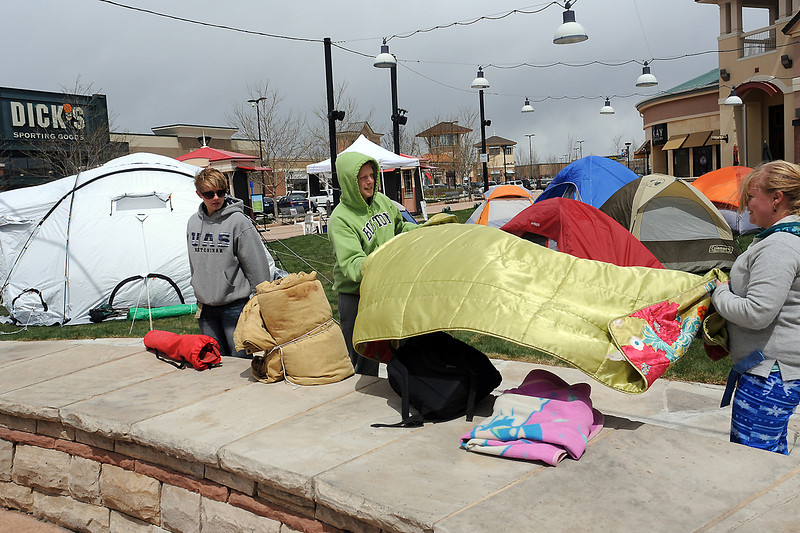 Volunteers break camp at the Promenade Shops at Centerra where Big Thompson Interact held a tent-a-thon to raise money and awareness for Shelter Box which provides tents and provisions for disaster victims. From left are Mountain View High School students Erin Flood, 17, Jacob Wilson, 17, and Meghan Tattershall, 17.