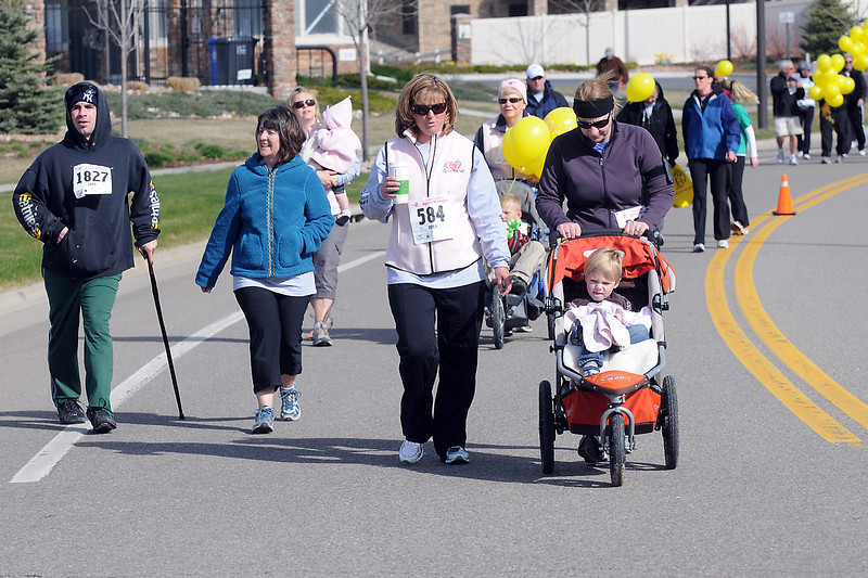 Walkers make their way around the course Saturday morning while participating in the Sierra's Race for the Cure 5K Run/Walk in northwest Loveland. Front from left are William Lafreniere Sylvie, Lafreniere, Marnie Green, Ann DePew and Ian Eppers, 4.