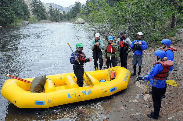 A-1 Wildwater trip leader Brandon Katz, left, gives instruction to rafters before putting in on the Poudre River during a commercial trip Wednesday northwest of Fort Collins.