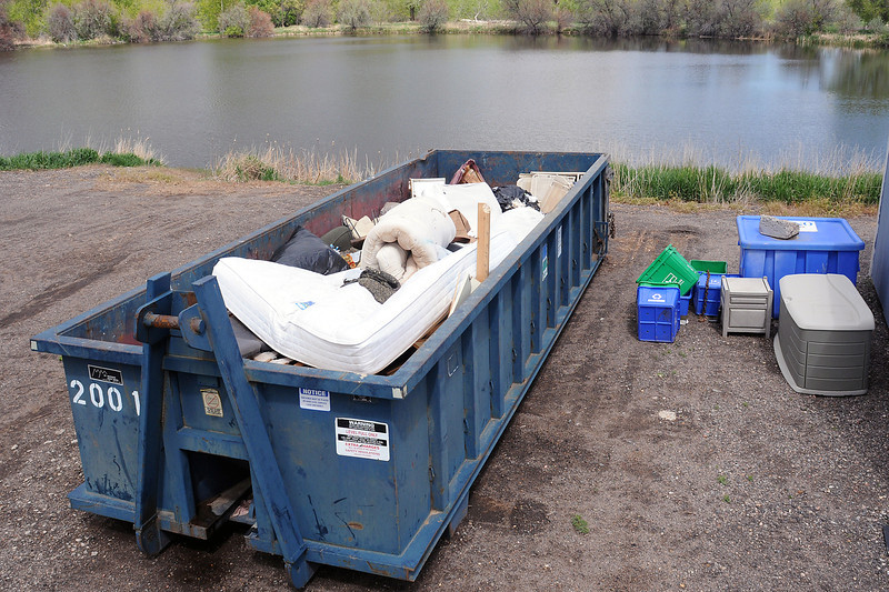 A 20-yard roll-off container at the Loveland Recycling Center holds large items like mattresses and chairs that were dropped off to be recycled.