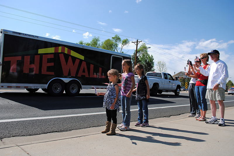 Lovelanders line Taft Avenue south of 29th Street to show support as the Traveling Vietnam Memorial Wall passes by in a trailer in Loveland on Wednesday May 22, 2013. From left are Brileigh Hail, Evley Hail, Tamsin Hail, Edwana Hail, Margaret Miosek and Bob Miosek.The Traveling Vietnam Memorial Wall passed through Loveland with an escort from multiple law enforcement agencies and members of the Combat Veterans Motorcycle Association on its way to Fort Collins where it will be on display this weekend.
