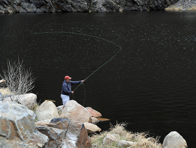 John Duran of Longmont casts his line into the Big Thompson River while fly fishing near the Idylwilde Dam on Monday, May 6, 2013.