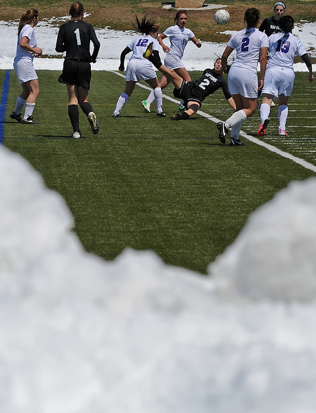 The Mountain View High School soccer team is framed by snow surrounding the turf field at the Loveland Sports Park as they play against Silver Creek High School in Loveland on Thursday, May 2, 2013.