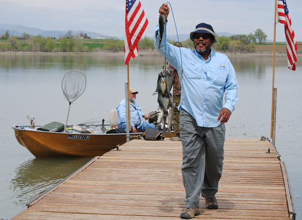 Vietnam veteran, Valentine Roberts, returns from a successful  day of fishing at Loveland Lake, at the Warriors on the Lake event on Saturday May18, 2013. (Photo by Lilia Munoz)