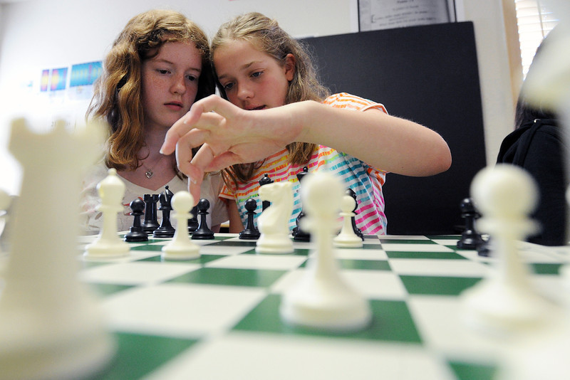 Resurrection Christian School seventh-graders Sierra Snyder, 12, left, and Kimberly Boland, 13, ponder their next move while playing chess during class Thursday, May 16, 2013 at the school.
