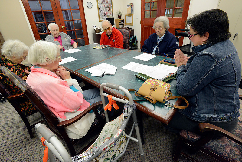 Tracy Morgan, far right, leads a groupof seniors in prayer during a bible study at Sterling House in Loveland on Friday, May 3, 2013. Clockwise from left are Eudora Autrey, Helen McDill, Marge Mullins, Paul Fromer and Maxine Zimbelman.