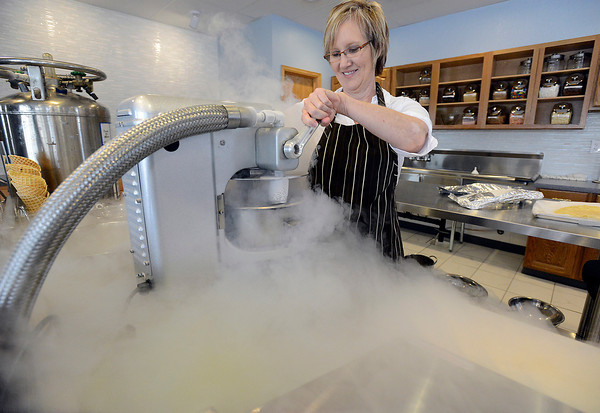 Christine Yount Jones, owner of the new Colorado Chill Creamery, a liquid nitrogen ice cream shop, makes a lemon blueberry ice cream in just seconds at the Loveland shop on Thursday, May 23, 2013.