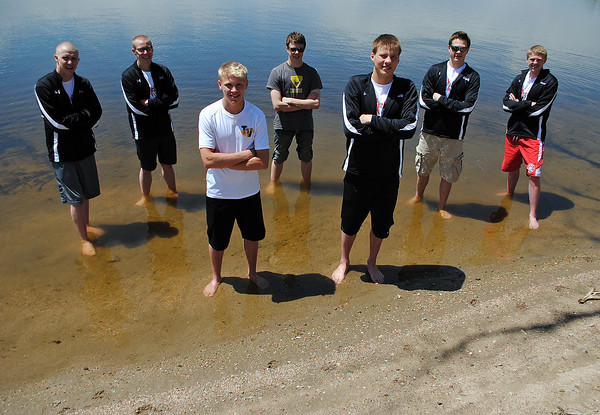 The Reporter Herald all area swimming team poses for a photo on the swim beach at Lake Loveland on Wednesday, May 22, 2013.