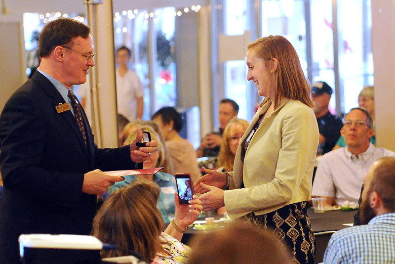 City Councilor Ralph Trenary, left, presents Boys and Girls Club volunteer Amanda White with a award during the Loveland Honors event Wednesday, May 15, 2013 at the Majestic Gathering Place, 315 E. Fourth St. in downtown Loveland.