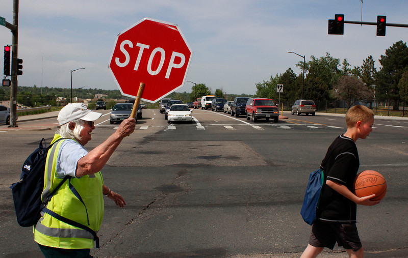 "Crossing guard Donna Wagner, left, escorts Bill Reed Middle School student Jarrod Houchin, 12, across Southwest 14th Street, on South Taft Avenue on Monday, May 28, in Loveland. Wagner will be retiring from what she says people call ""Donna's corner"" this Thursday, May 30 after helping students cross safely for four years. Talking about her favorite aspect of the job, Wagner said ""Watching little kids growing up."" She plans to continue volunteering wherever she can after her retirement."