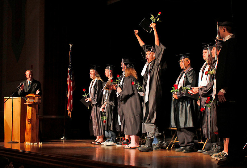 Ferguson High School graduate Nate Posten, center, throws his hands up in celebration after being commenced, Thursday night , May 30, at the Bill Reed Auditorium in Loveland, Colo.