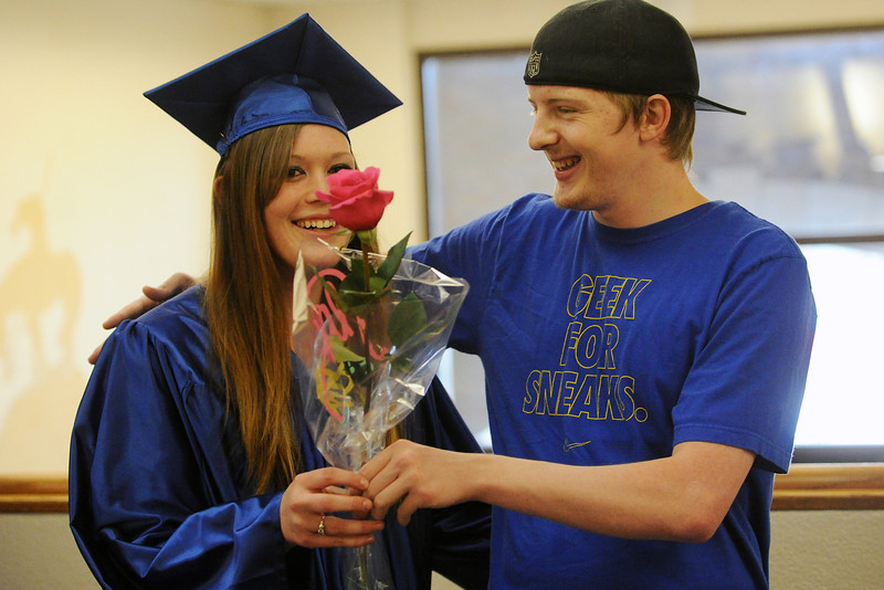 Kasie Moritz, left, is greeted by Harley Fait as she prepares to enter Bill Reed Auditorium for the Center for Adult Learning's Graguation and Recognition Night on Wednesday, May 15, 2013.