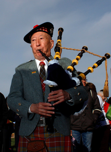"A bagpiper plays as 122 veterans fill four busses at the Embassy Suites Loveland parking lot Sunday morning in Loveland. The veterans are participating in the ""Honor Flight Northern Colorado"" program which flies veterans, including 25 from Loveland and Berthoud, to Washington, D.C., to visit war monuments."