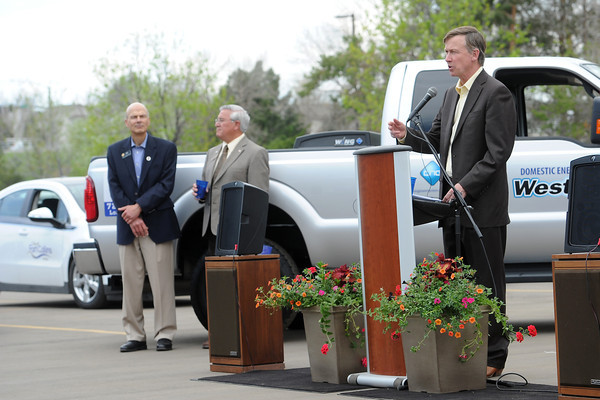 Colorado Gov. John Hickenlooper, right, speaks during a signing ceremony for two alternative energy bills on Wednesday, May 15, 2013 at the City of Loveland's Water and Power Division.