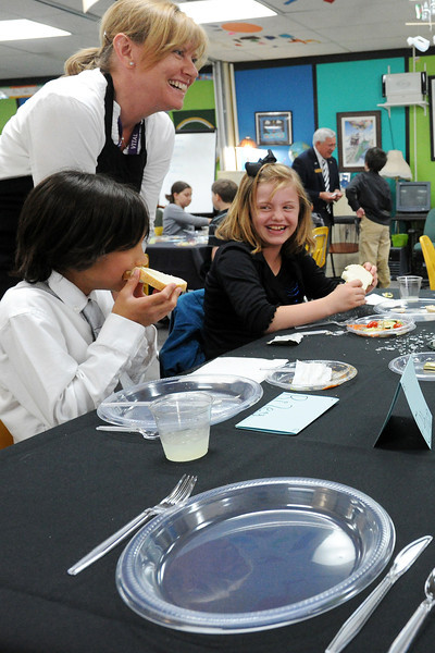 Parent volunteer Terry Mendoza shares a laugh with Carrie Martin Elementary School fourth-graders Riley Keeler, 9, front left, and Hannah Webster, 10, during an etiquette luncheon Wednesday, May 8, 2013 at the school.