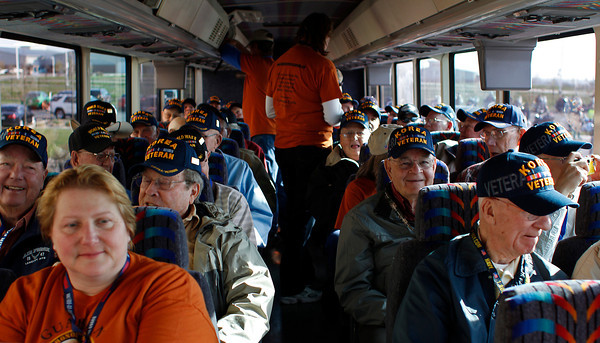 "Veterans settle in for their bus ride to Denver International Airport Sunday morning in Loveland, where they will be flying to Washington, D.C. as participants of ""Honor Flight Northern Colorado."" The veterans, including 25 from Loveland and Berthoud, will be visiting war monuments while on the trip."