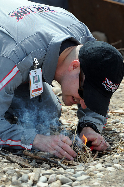 Air Link flight paramedic Matt Carter practices buliding a fire during survival training Wednesday, May 8, 2013 at the City of Loveland Fire Rescue Authority Training Center for helicopter crew who work at Medical Center of the Rockies.