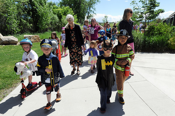 Carson Klein, 4, left, Lucas Cameron, 5, Zack Bakker, 5, and Ty Bakker, 6, walk together during the 37th annual Pet and Doll Parade on Thursday, May 30, 2013 at Fairgrounds Park.