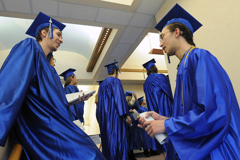 Loveland resident Anthony Marquez, right, and Ian Chella of Longmont chat together Wednesday, May 15, 2013 before the Center for Adult Learning Graduation and Recognition Night event at the Bill Reed Auditorium.