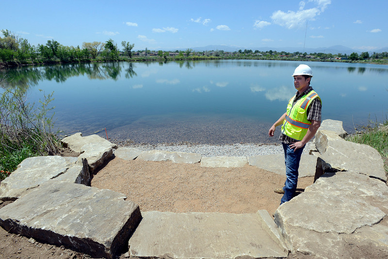Rob Burdine, open lands manager for the City of Loveland, talks about the design of River's Edge Natural Area as he stands at one of the new belly boat access areas on Dragonfly Pond in Loveland on Friday, May 24, 2014. Construction crews are currently working on the natural area, which is Loveland's newest open space. Designs for the site include wetland enhancements on all three ponds to create a fish habitat. Crews will also work to construct a new bridge over Ryan Gulch to connect trails from River's Edge to the adjacent Jayhawker Ponds. The city plans for the site to be open and ready for public access this fall.