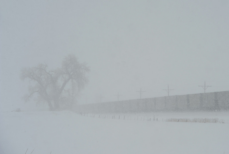 A train heads north of 57th Avenue in Loveland on a snowy Wednesday, May 1, 2013.