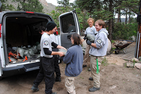 Americorps volunteers unload sandbags from a van in Poudre Park on Monday May 20, 2013. Clockwise from far left are Russ Lee, Meg Conery, Shawn Decker, Amy Tylliann, and Michael Durkan.
