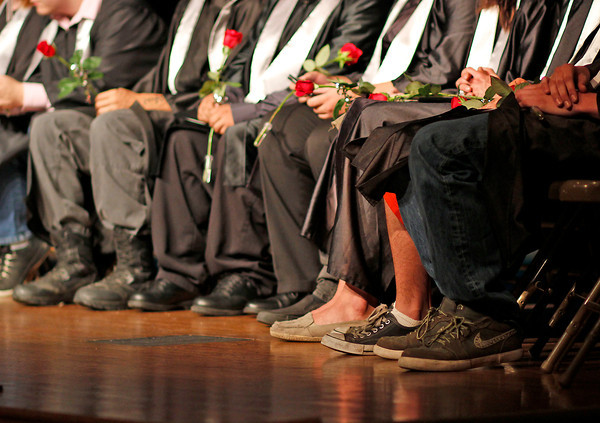 Ferguson High School graduates wait to be officially commenced after receiving their diplomas and roses, Thursday night , May 30, at the Bill Reed Auditorium in Loveland, Colo.
