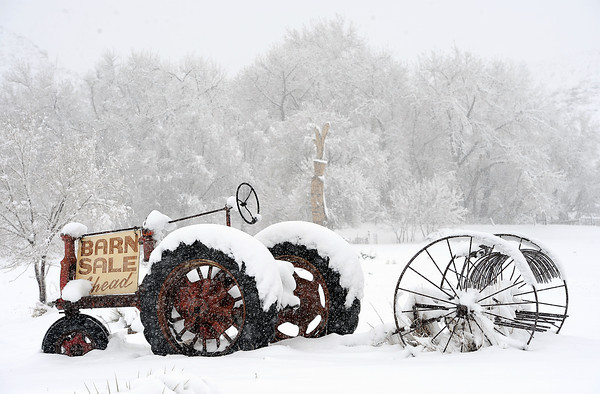 An old tractor sits in a snowy field on the corner of U.S. 34 and Larimer County Road 29 in west Loveland on Wednesday, May 1, 2013.