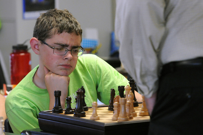 Resurrection Christian School seventh-grader Edward Fantauzzo, 13, watches as Brad Lundstrom moves a chess piece while Lundstrom competes against an entire classroom of students at once on Thursday, May 16, 2013 at the school.