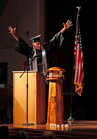 "Ferguson High School graduate Nate Posten, center, throws his hands up in celebration after being given his high school diploma, exclaiming to his fellow graduates, ""We're done,"" Thursday night , May 30, at the Bill Reed Auditorium in Loveland, Colo."