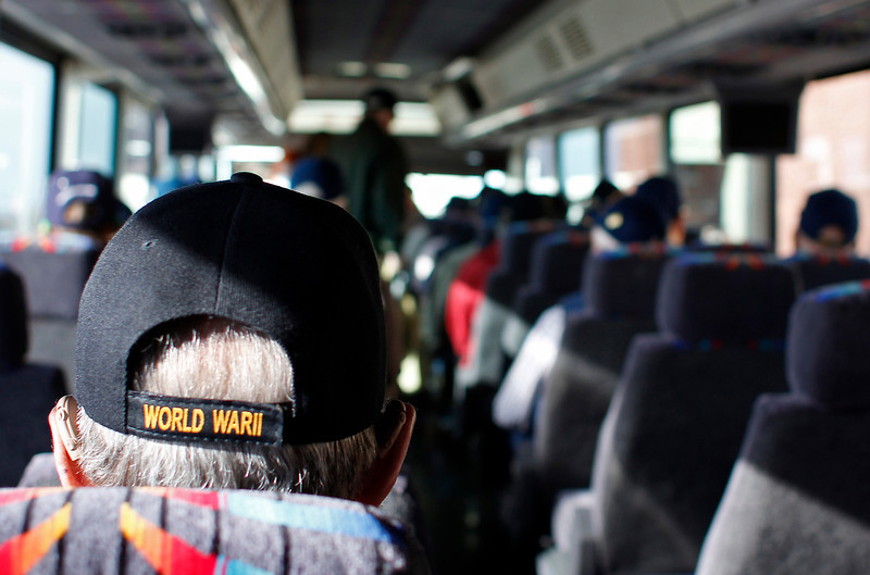 """Dick Tedesco Sr., left, waits as his bus, headed to Denver International Airport, fills with fellow veterans who will be flying to Washington, D.C., to visit war monuments as part of the """"Honor Flight Northern Colorado"""" program. Tedesco is a U.S. Navy veteran of World War II, who was just off Japan when Hiroshima was bombed."""