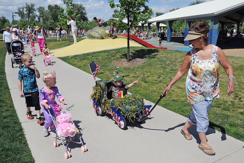 Kathy Meyer, right, pulls her grandson Gage Christian, 2, in a wagon while walking alongside Sean Balch, 5, right, and Cora Balch, 2, in the 37th annual Pet and Doll Parade on Thursday, May 30, 2013 at Fairgrounds Park.