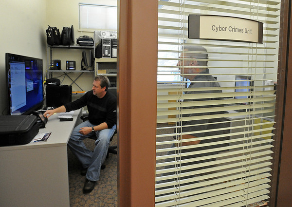 Loveland Police detectives Brian Koopman, left, and Eric Roberts work in the Cyber Crimes Unit of the LPD on Thursday, May 2, 2013.