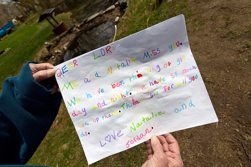 Lori Shaffer, co-owner of the Drake Campground, shows off a note she received from two young girls who have been camping there with their family since they were babies. Lori and her husband, Jeff, have operated the campground west of Loveland for 30 years and say it would be a loss to all the people who enjoy it if Larimer County makes them shut down.
