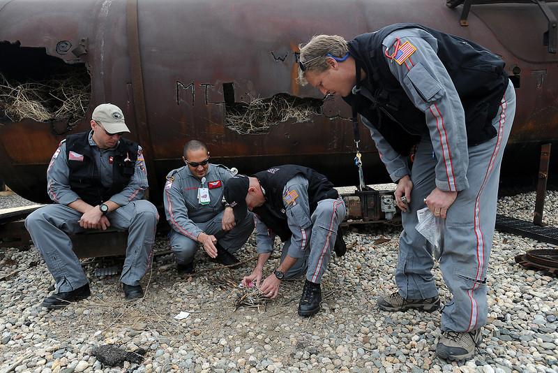 Air Flight crew members from the Medical Center of the Rockies, from left, Kris Schott, Greg Clark, Duane Rorie and Keith Volk practice survival training skills by trying different techniques to light fires Wednesday, May 8, 2013 at the Loveland Fire Rescue Authority Training Center