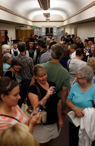 Friends and family members of Ferguson High School graduates congregate in the hallway right outside the Bill Reed Middle School auditorium after commencement, Thursday night , May 30, at the Bill Reed Auditorium in Loveland, Colo.