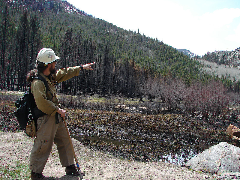 Mark Mendonca, captain of the Alpine Hot Shot crew housed at Rocky Mountain National Park, on Monday, May 13, 2013, describes the path of the Fern Lake Fire that spread from an illegal campfire in October and spread to nearly 4,000 acres, including a race through Moraine Park in late November.