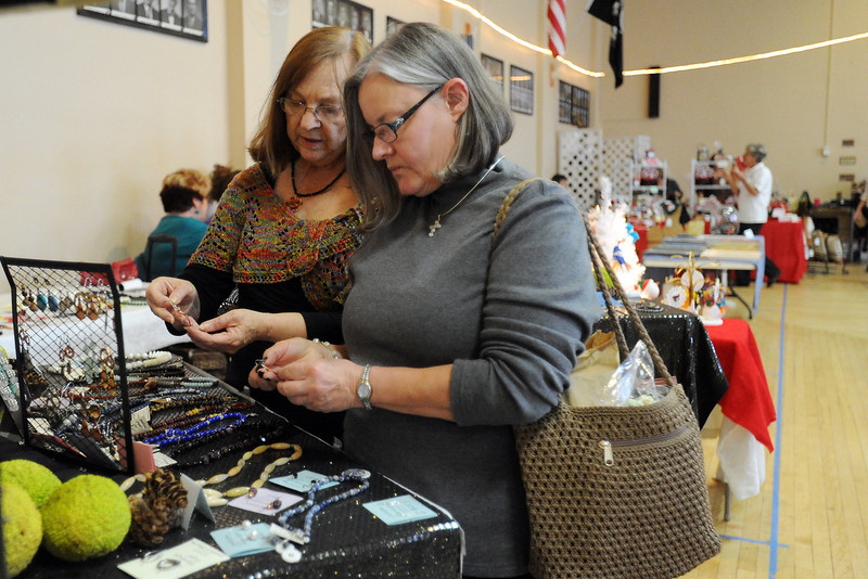 Loveland resident Joyce O'Donnell, right, looks at jewelry with Barbara Mullaney at Mullaney's booth during the Loveland Elks Arts and Crafts Show on Saturday, Nov. 3, 2012.