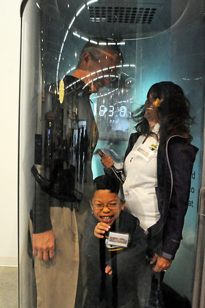 Eight-year-old Timmy Atteberry of Fort Collins can't get enough of the tornado chamber Saturday during the opening day of the Fort Collins Museum of Discovery. His father, Fort Collins city manager Darin Atteberry, and his mother, Deborah Atteberry, joined him to experience 78 mph winds. (Photo by Craig Young)