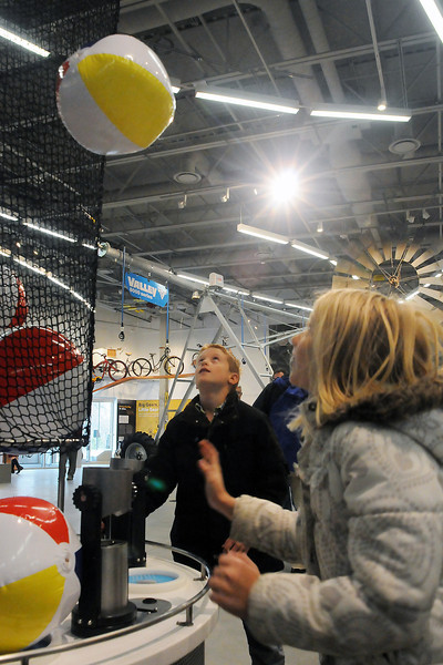 Cody Robertson and his cousin, Kylie Robertson, both 10-year-old Fort Collins residents, keep beach balls aloft with streams of air during their visit Saturday to the Fort Collins Museum of Discovery. (Photo by Craig Young)