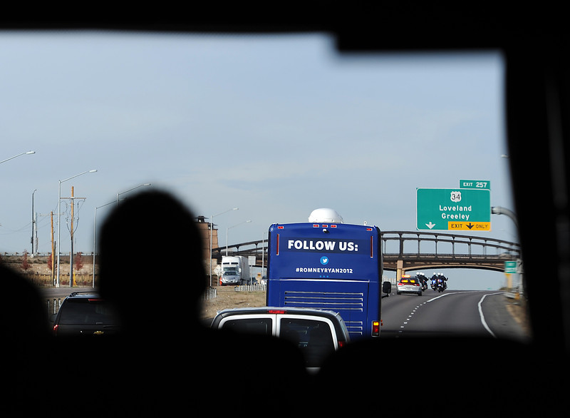 Vice presidential candidate Paul Ryan travels in a motorcade seen through the windshield of another bus in the line of vehicles heading to the airport in Loveland Monday after speaking in Johnstown.