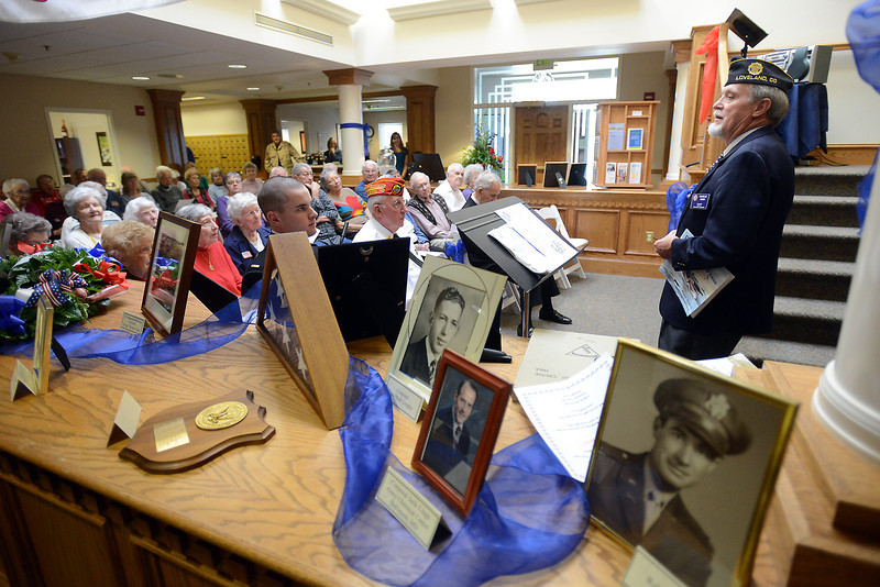 "Charlie Nash, right, gives a presentation called ""A Veteran's Life"" during an event Friday, Nov. 9, 2012 at The Wexford independent living facility in Loveland to honor military veterans. Also unveiled during the event was the Wexford Honor Wall containing plaques for residents who are veterans."
